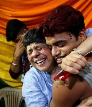 People belonging to the lesbian, gay, bisexual and transgender (LGBT) community celebrate after the Supreme Court's verdict of decriminalizing gay sex and revocation of the Section 377 law, at an NGO in Mumbai