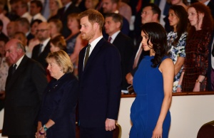 Britain's Duke and Duchess of Sussex, Prince Harry and his wife Meghan, stand for the National anthem before a gala concert in support of charities for military veterans who face mental health challenges, in London