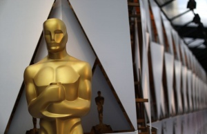 An Oscar statue is seen outside the Dolby Theatre during preparations for the Oscars in Hollywood, Los Angeles
