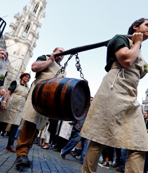 Bearers carry a barrel of beer on Grand Place ahead of a mass at Saint Gudula Cathedral in Brussels