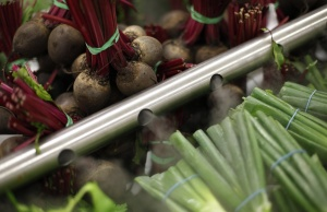 Beets and onions are misted to keep fresh at a Tesco Extra supermarket in Watford, north of London