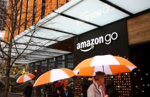 People walk by the entrance to the new Amazon Go store at Amazon's Seattle headquarters in Seattle