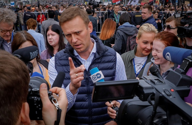 Russian opposition leader Alexei Navalny attends a rally in protest against court decision to block the Telegram messenger because it violated Russian regulations, in Moscow