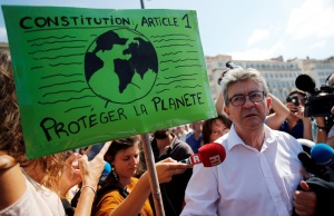 """Jean-Luc Melenchon, leader of far-left opposition """"France Insoumise"""" (France Unbowed) political party attends a demonstration to urge world leaders to take action against climate change in Marseille"""