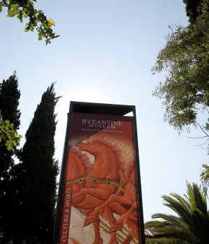 An exhibition banner is seen at the entrance of the Byzantine Museum in Athens