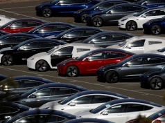 Rows of new Tesla Model 3 electric vehicles in Richmond California