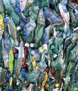 Crushed plastic bottles are seen at a recycling plant near Laval, western France