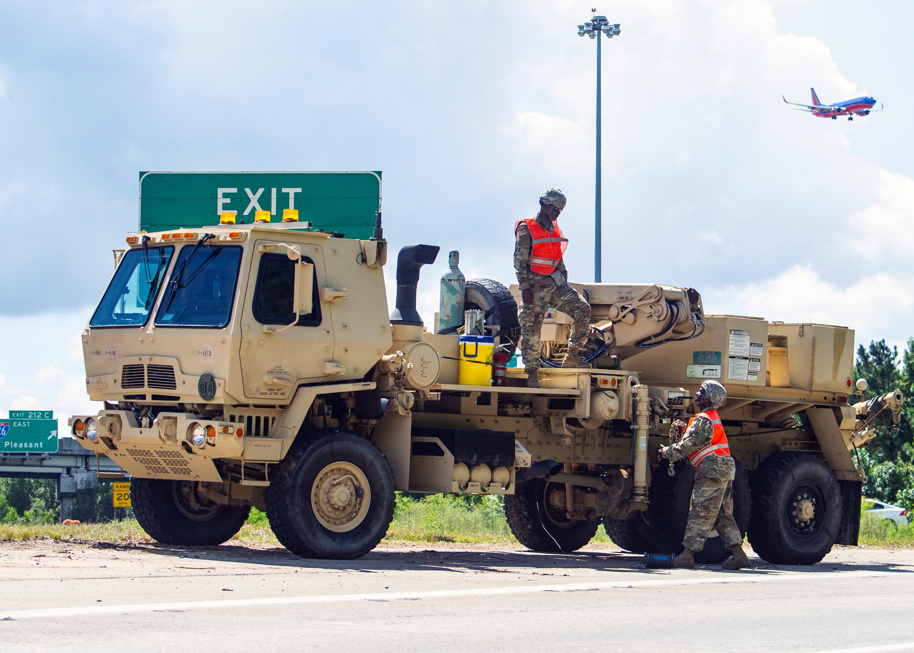 South Carolina Army National Guard soldiers prepare recovery equipment to provide support for disabled vehicles