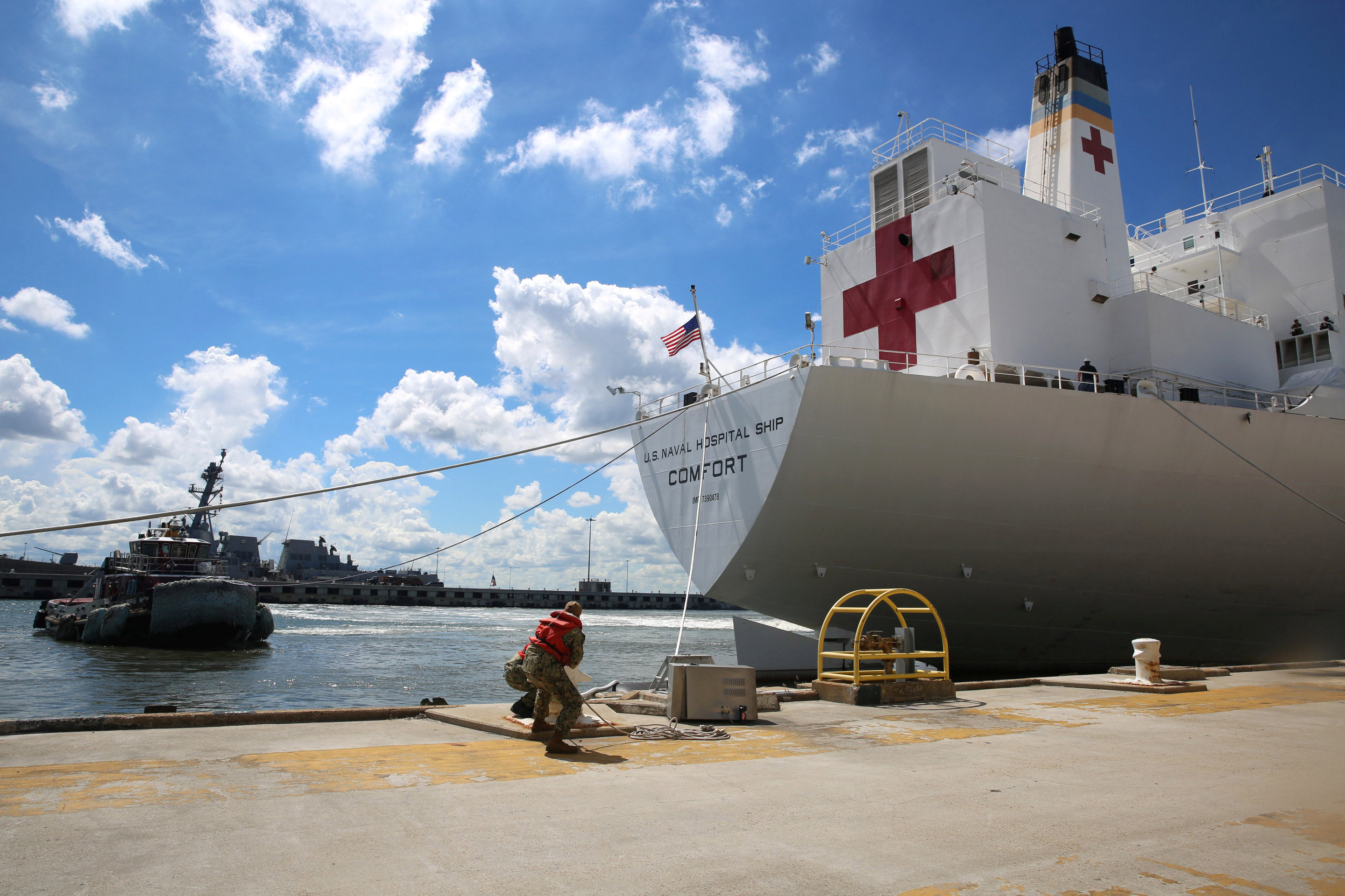 A U.S. Navy handout photo of sailors casting off mooring lines to the Command hospital ship USNS Comfort as the ship evacuates Naval Station Norfolk in preparation for Hurricane Florence in Norfolk