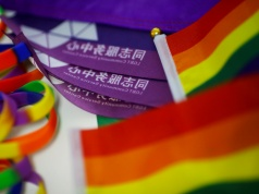 Rainbow flags lie on the desk of Liu Yifu, an organiser of a 5.17 km run to mark International Day Against Homophobia in Beijing