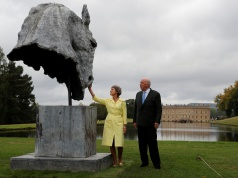 "The Duke and Duchess of Devonshire look at a sculpture entitled ""Into the Wind"" by Nic Fiddian-Green during the Chatsworth Outdoors exhibition at Chatsworth House near Edensor"