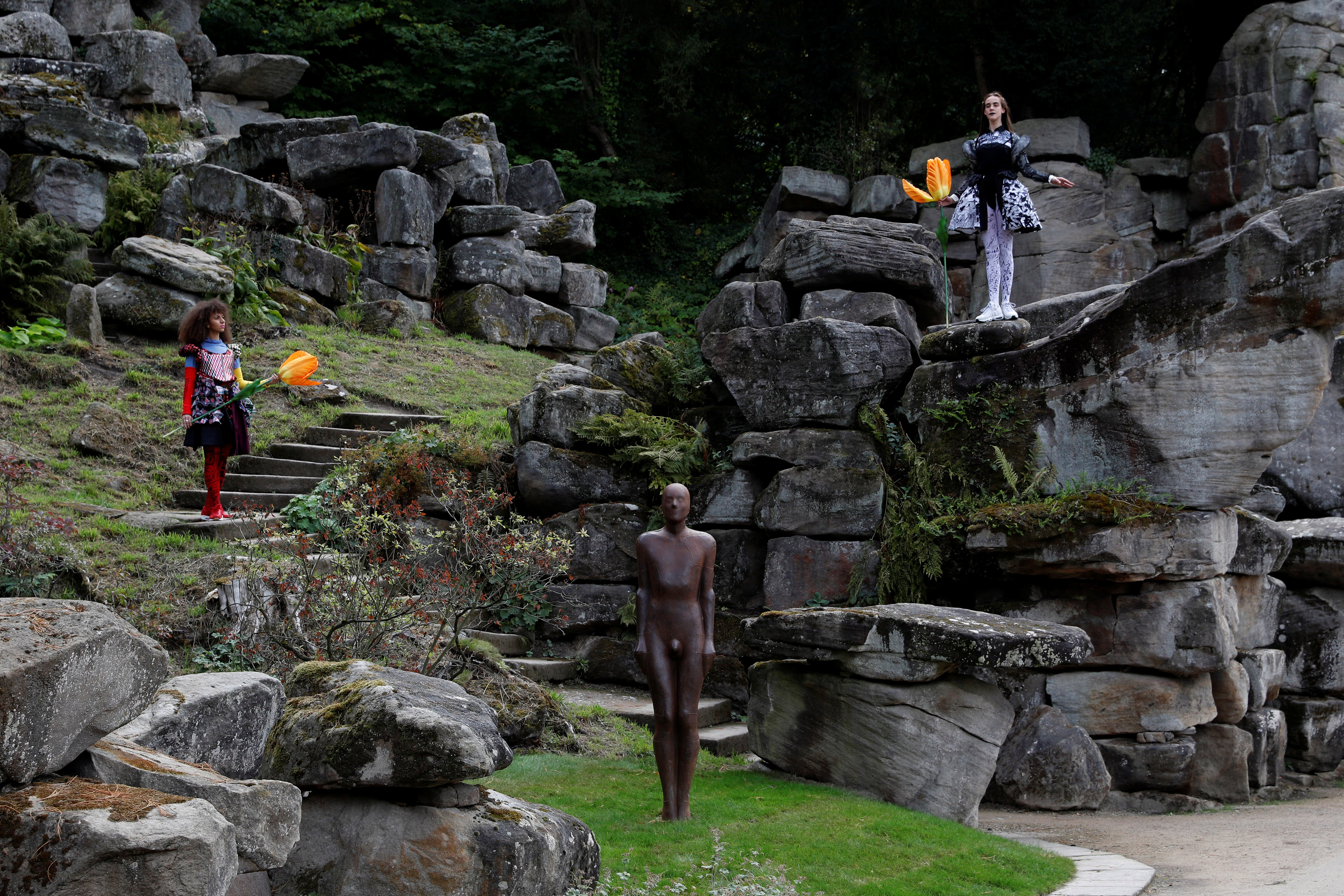 "Dancers perform next to a sculpture by Antony Gormley entitled ""Learning to be I"" during the Chatsworth Outdoors exhibition at Chatsworth House near Edensor"