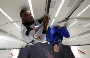 Retired sprinter Usain Bolt and French astronaut Jean-Francois Clervoy enjoy zero gravity conditions during a flight in a specially modified plane above Reims
