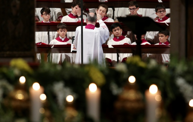 he choir of Sistine Chapel is seen before the arrival of Pope Francis to lead the Feast of the Presentation of the Lord mass in Saint Peter's Basilica at the Vatican