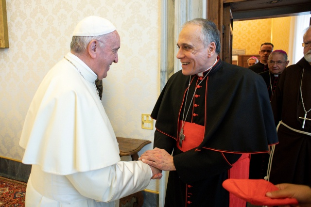Pope Francis shakes hands with Cardinal Daniel DiNardo, Archbishop of Galveston-Houston, as he arrives with other U.S. Catholic Church leaders at the Vatican