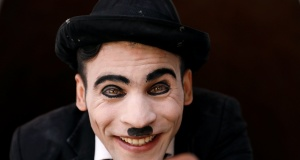 Afghanistan's Charlie Chaplin, Karim Asir, 25, looks on during his rehearsals in Kabul