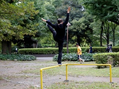 Office worker exercises during a lunch break at a park in central Tokyo