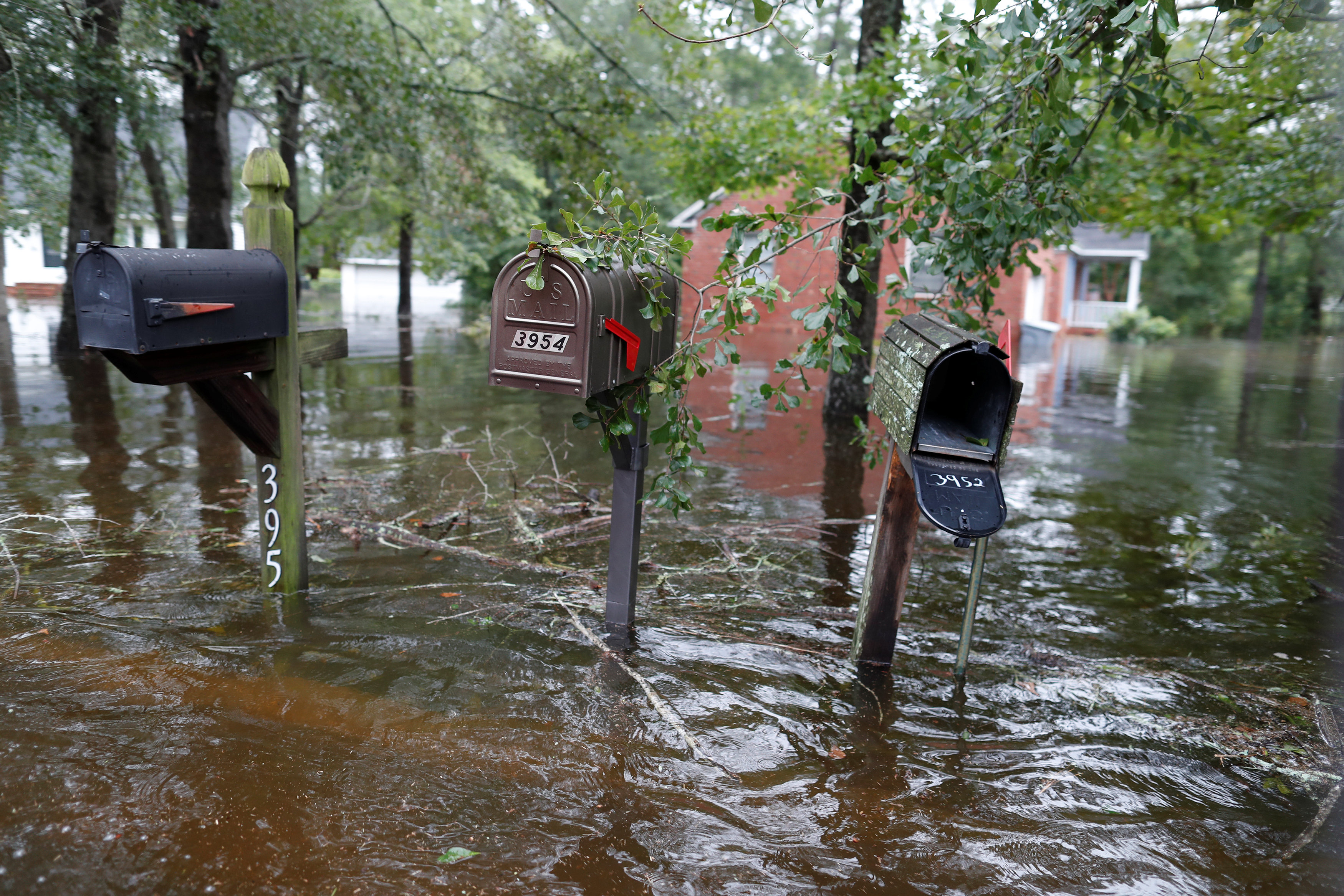 Floodwater rises on mailboxes in the Mayfair community during Tropical Storm Florence in Lumberton