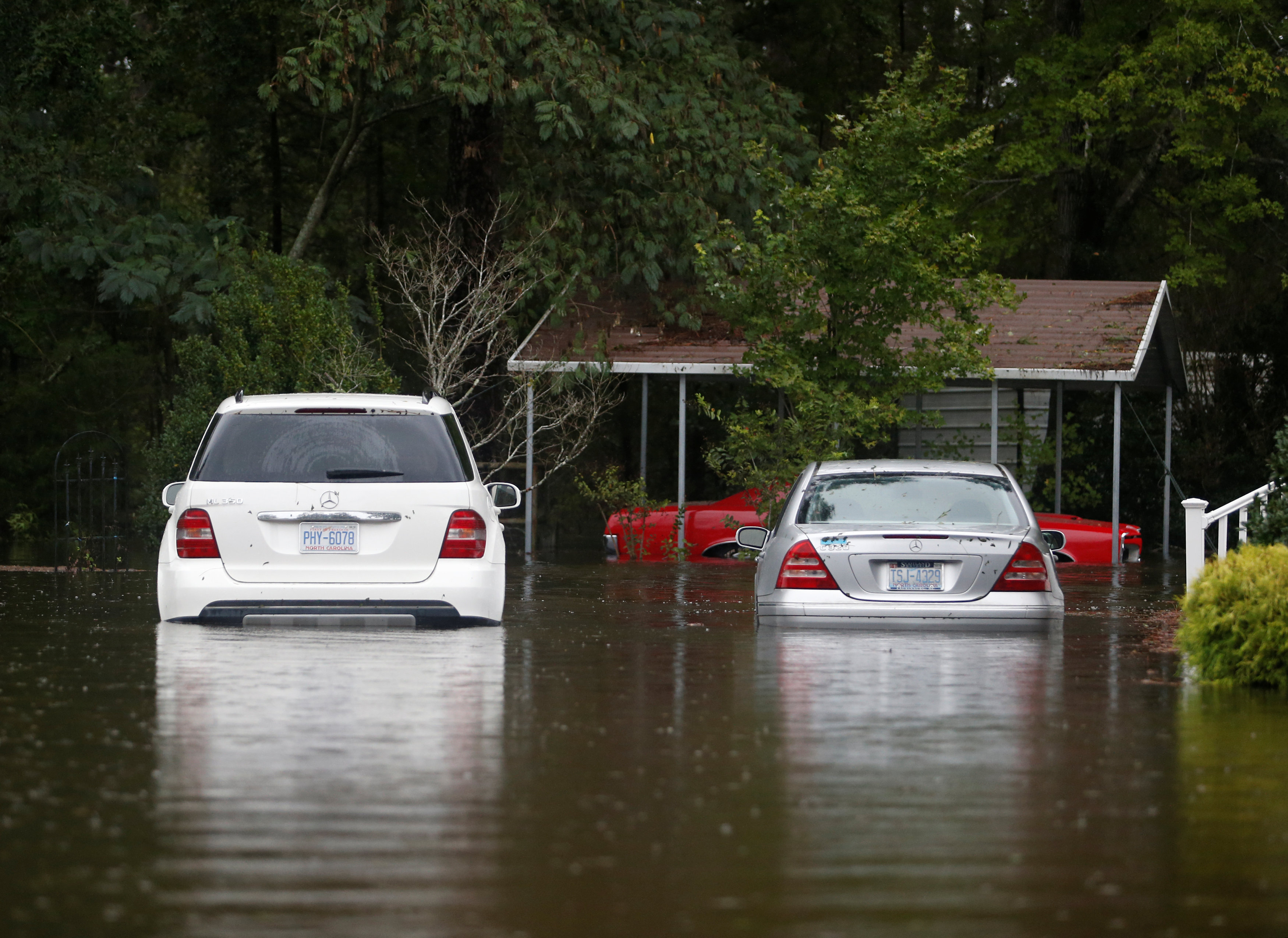 Cars sit flooded in the Mayfair community during Tropical Storm Florence in Lumberton