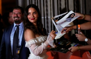 Actor Olivia Munn signs autographs at the premiere of The Predator during the Toronto International Film Festival (TIFF) in Toronto