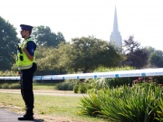 A police officer guards a cordoned off area of Queen Elizabeth Gardens, after it was confirmed that two people had been poisoned with the nerve-agent Novichok, in Salisbury