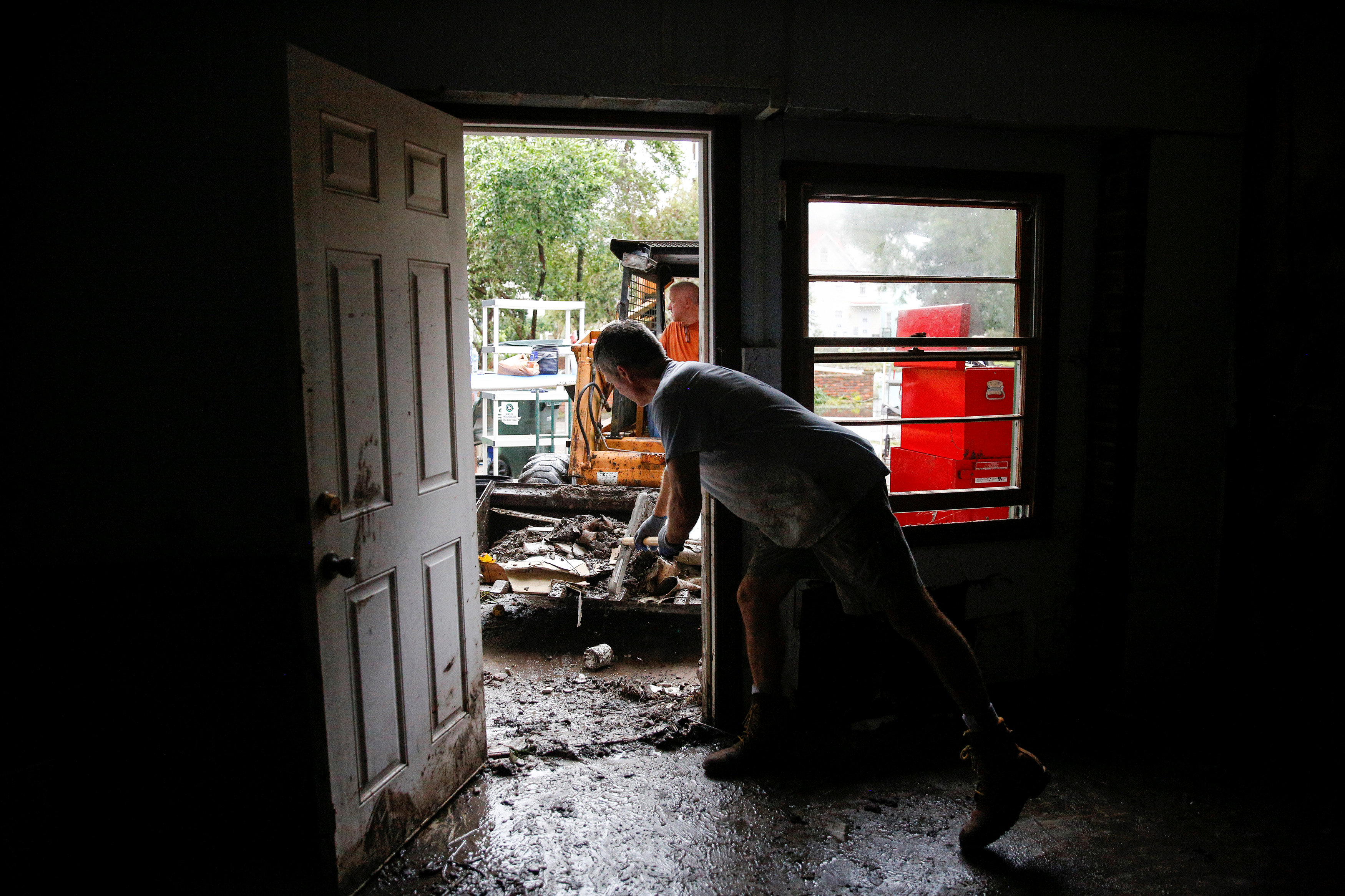 People clean their house after the pass of Hurricane Florence in New Bern, North Carolina