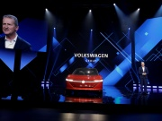 Herbert Diess, Volkswagen's new CEO, speaks next to a Volkswagen I.D. concept car at a media event in Beijing