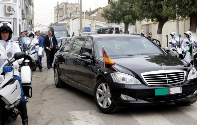 A convoy carrying German Chancellor Angela Merkel drives along a street in Algiers