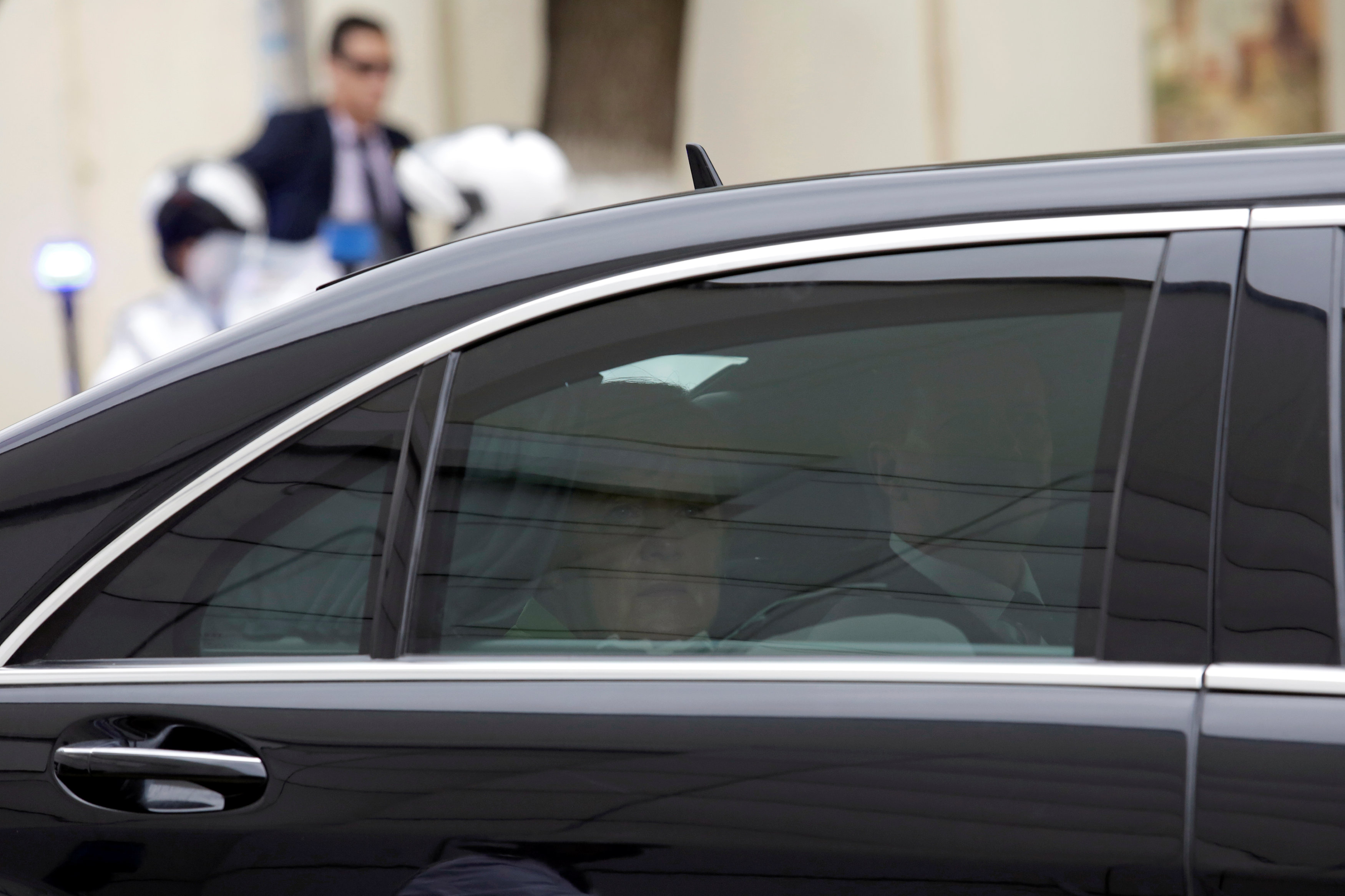 German Chancellor Angela Merkel is pictured inside a vehicle during her visit to Algiers