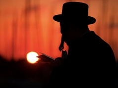 An ultra-Orthodox Jewish man performs the Tashlich ritual ahead of Yom Kippur in Ashdod, Israel