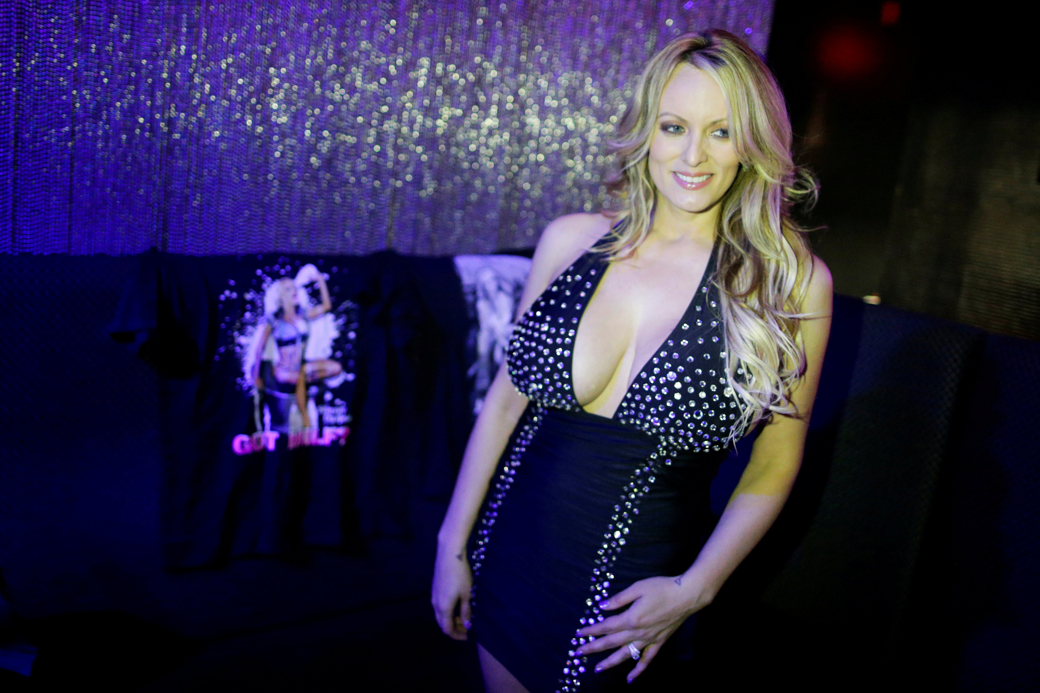 Adult-film actress Clifford, also known as Stormy Daniels, poses for pictures at the Gossip Gentleman club in Long Island
