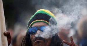 A man smokes marijuana, known locally as dagga, during a march calling for the legalisation of cannabis in Cape Town