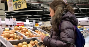 A woman buys vegetables at a supermarket in Buenos Aires