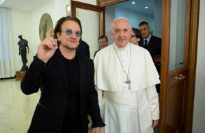 U2 rock band frontman Bono Vox meets Pope Francis at the Vatican