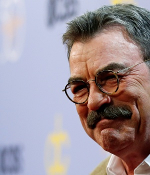"""Actor Selleck poses after arriving for the taping of """"The Carol Burnett 50th Anniversary Special"""" at CBS Studios in Los Angeles"""