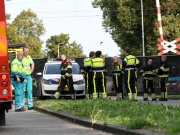 "Rescue personnel work at the scene where a train struck a ""cargo bicycle"" popular with Dutch parents to transport their children at the city of Oss"
