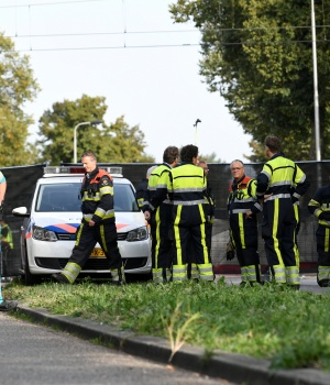 """Rescue personnel work at the scene where a train struck a """"cargo bicycle"""" popular with Dutch parents to transport their children at the city of Oss"""