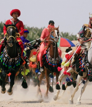 Local actors ride horses and dressed as ancient warriors re-enact a scene from the 7th century battle of Karbala to commemorate Ashura in Najaf
