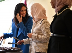 Meghan, Duchess of Sussex helps to prepare food at an event to mark the launch of a cookbook with recipes from a group of women affected by the Grenfell Tower fire at Kensington Palace in London