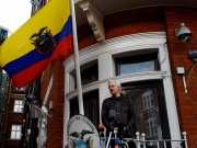 WikiLeaks founder Julian Assange is seen on the balcony of the Ecuadorian Embassy in London