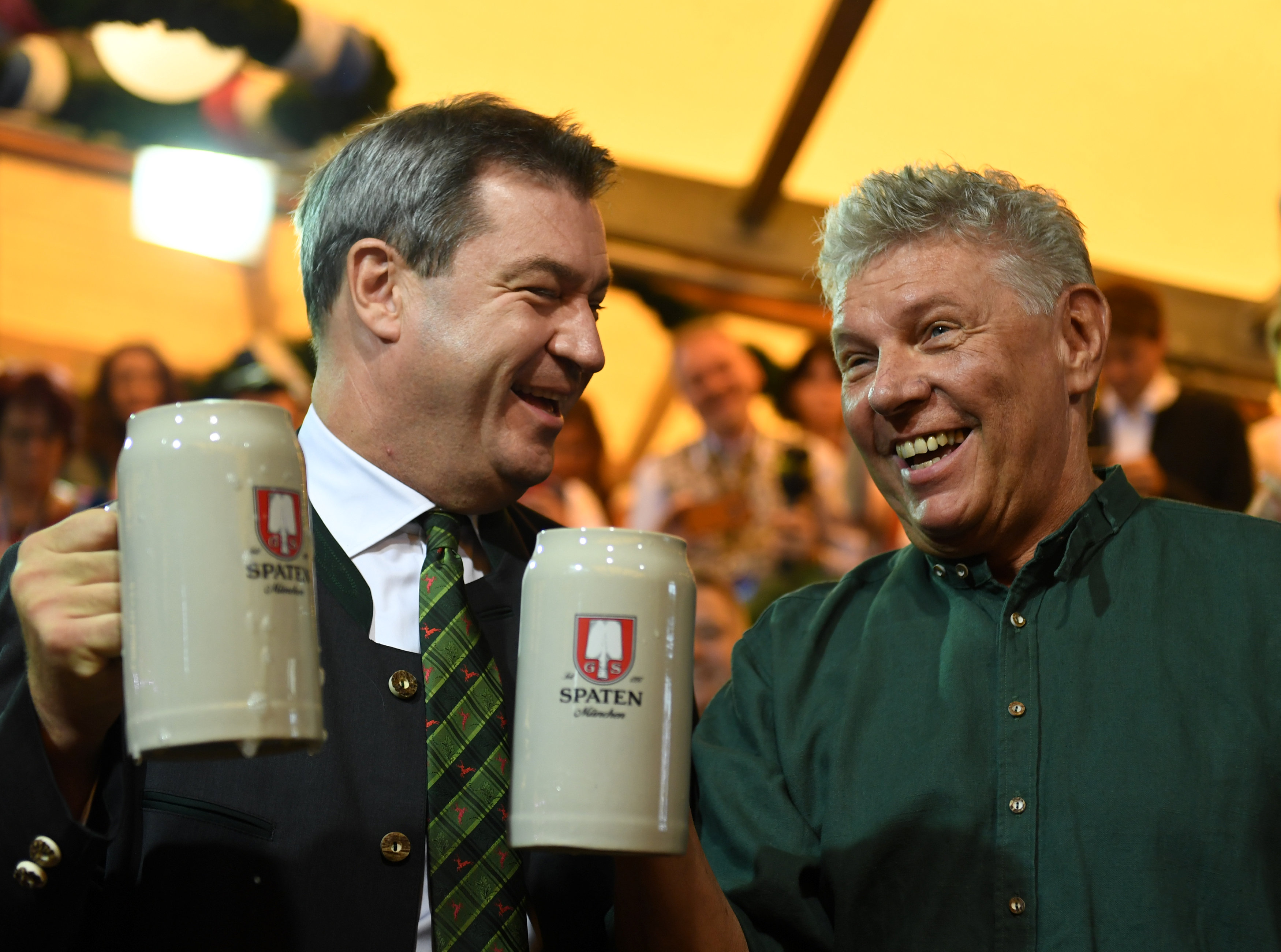 Munich mayor Dieter Reiter and Bavarian State Prime Minister Markus Soeder toast with beers at the opening day of the 185th Oktoberfest in Munich