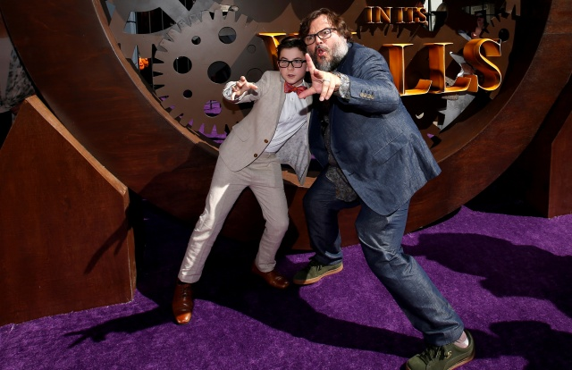 Actors Jack Black and Owen Vaccaro pose at the premiere for