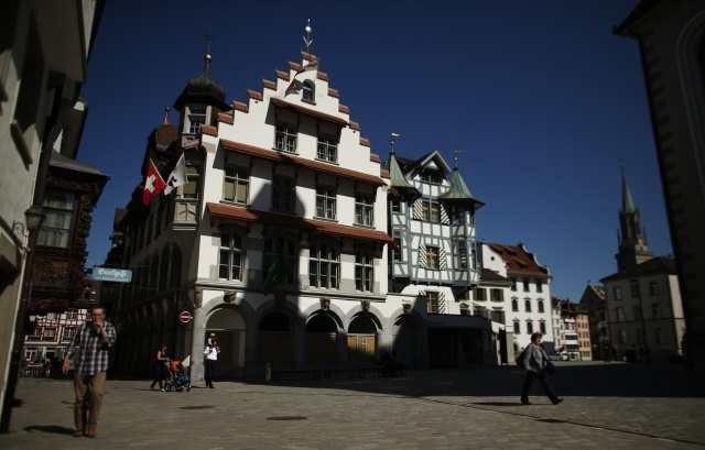 People walk in the old town of St. Gallen