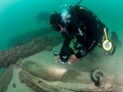 Divers are seen during the discovery of a centuries-old shipwreck, in Cascais