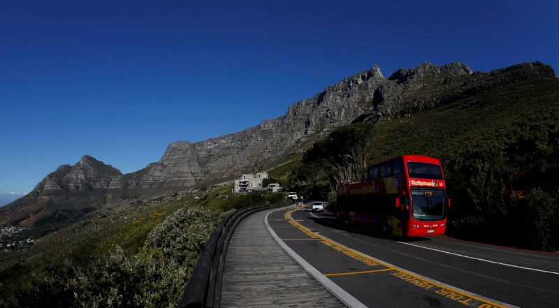 A tour bus carries visitors to Table Mountain in Cape Town