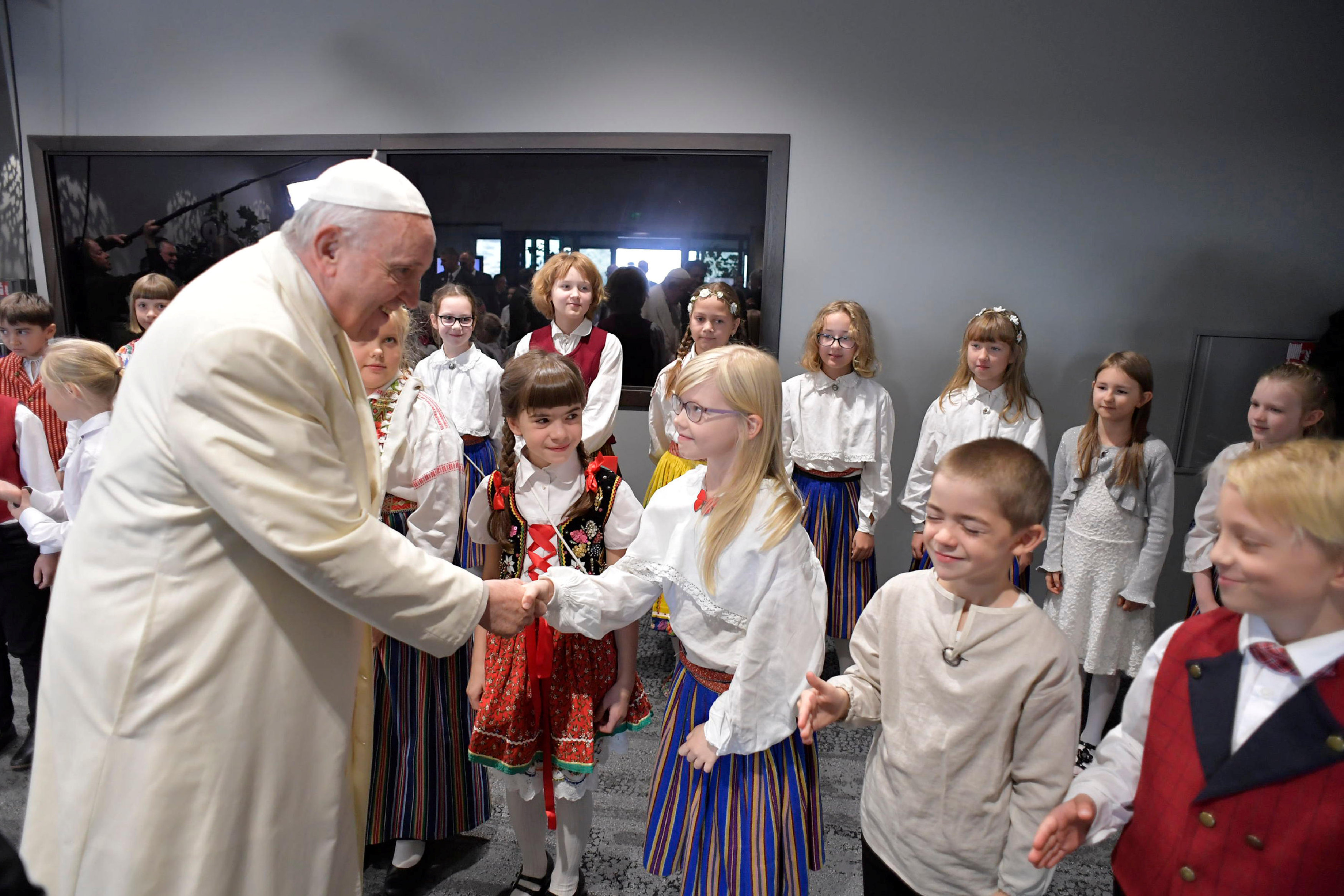 Pope Francis is welcomed at the airport in Tallinn