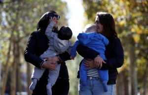 Amandine Giraud and her wife Laurene Corral pose with their children Makenzy and Leandre conceived with fertility assistance during an interview with Reuters in Paris