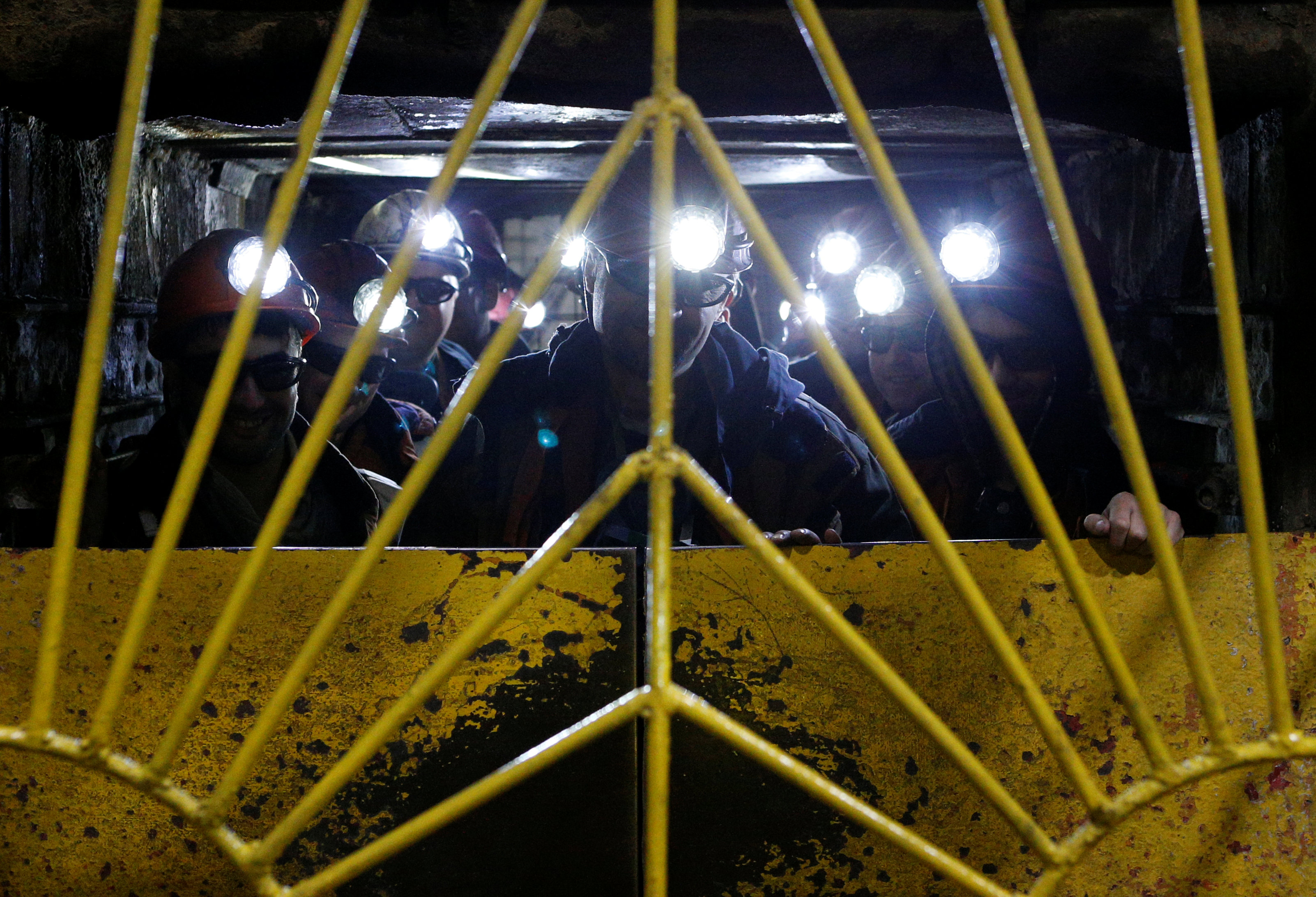 Miners gather inside an elevator before descending into the Vorgashorskaya mine near the far northern city of Vorkuta