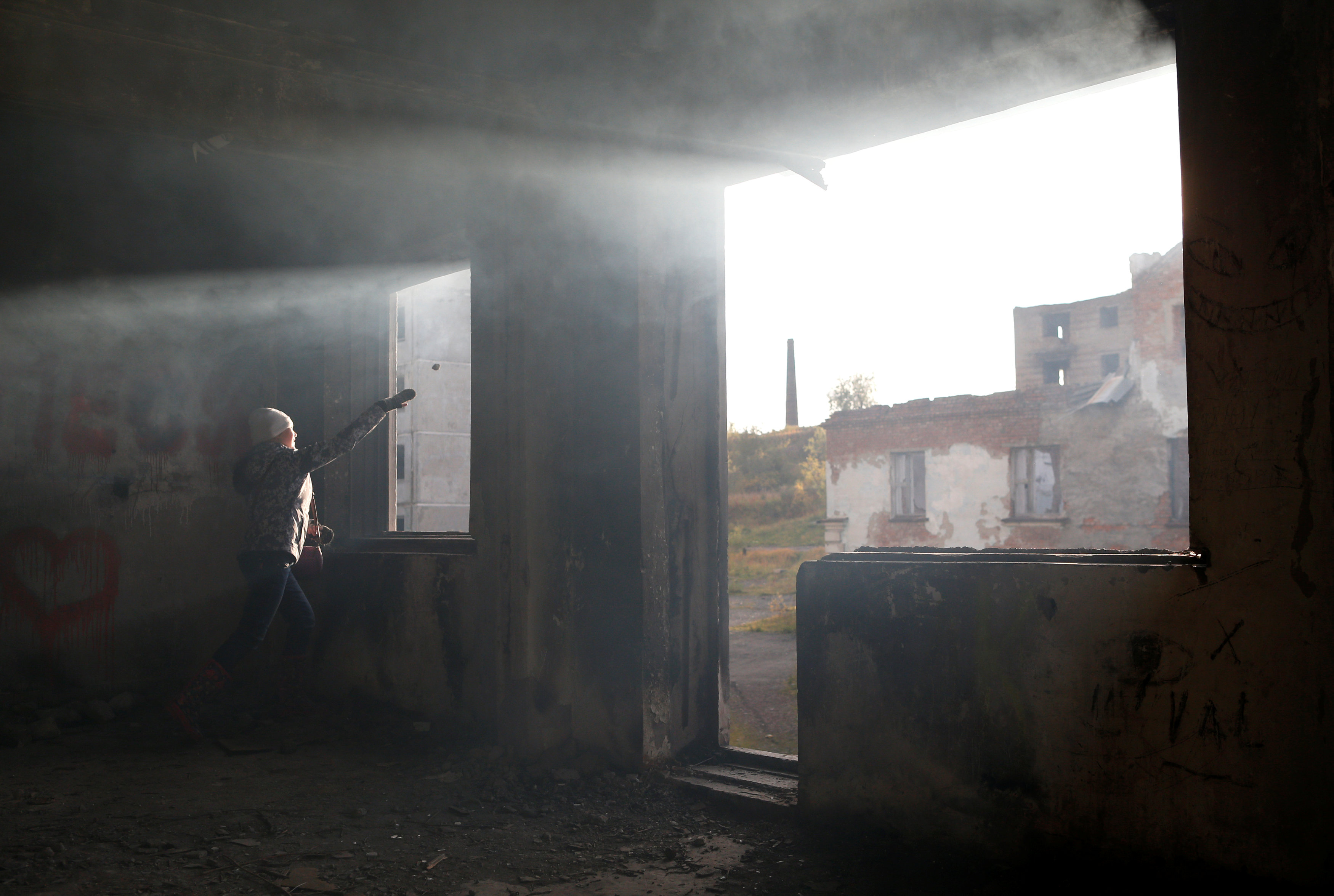A girl plays inside an abandoned building in Rudnik settlement near the far northern city of Vorkuta
