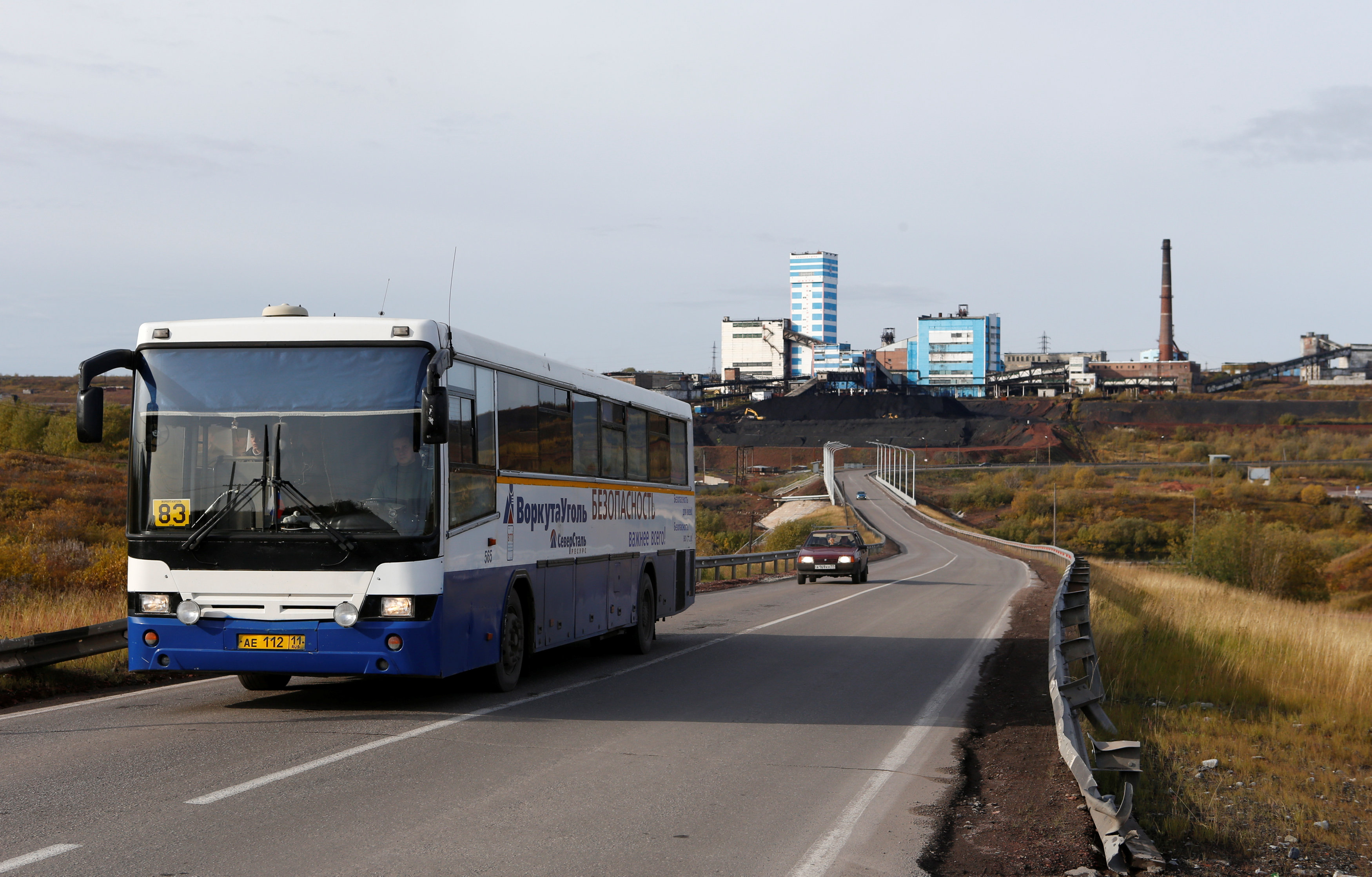 A bus, transporting employees of Vorkutaugol company, is seen on a motorway, which connects Vorkutinskaya coal mine and the city of Vorkuta